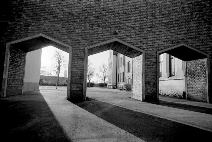 Brick arches with shadows, in black and white.